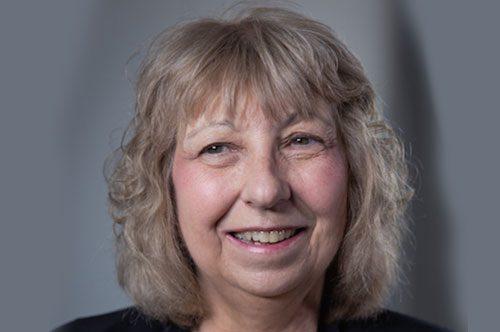 Sue J. Loves Her Dental Implant From Highland Advanced Dental Care